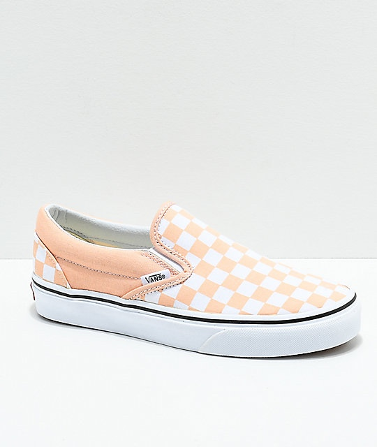 Peach checkered slip on vans