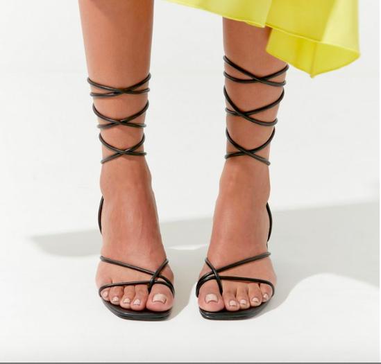 Dope Fashion Sense. Girl standing. lace up heels. black heels