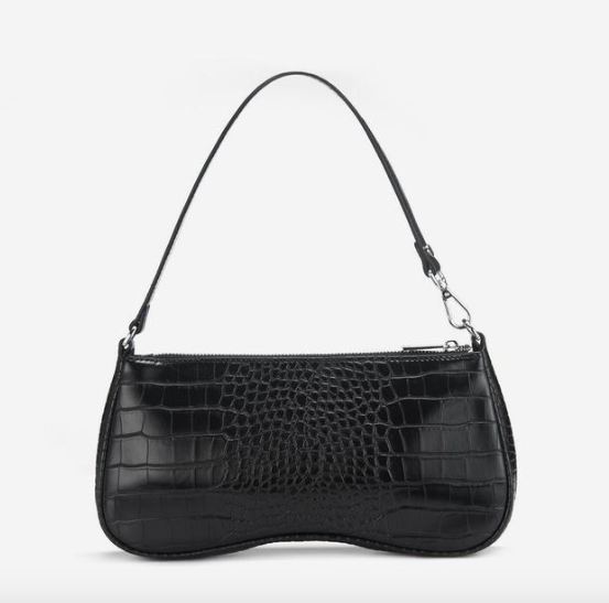 Dope Fashion Sense. Girl standing. black should bag. black handbag