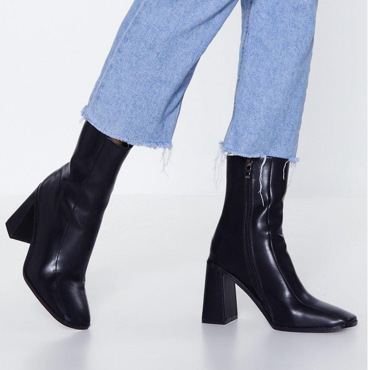 Dope Fashion Sense. Girl standing. black boots