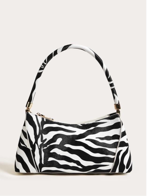 Dope Fashion Sense. Girl standing. black and white bag