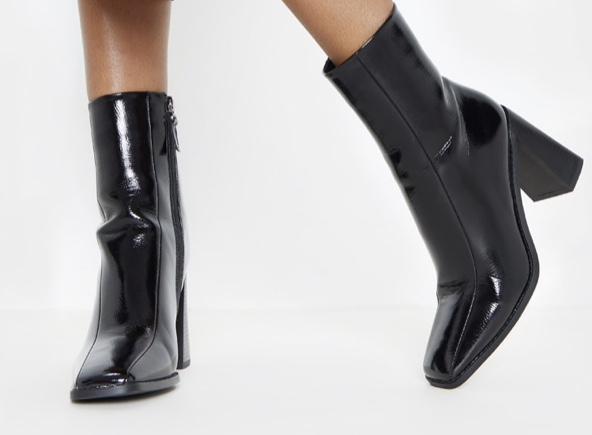 Dope Fashion Sense. Girl standing. black shiny boots