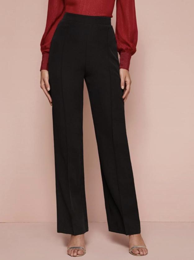 Dope Fashion Sense. Girl standing. black pants
