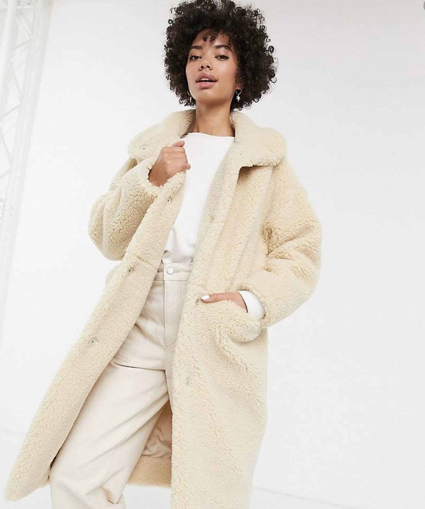 girl in coat. a girl standing. dope fashion sense. dopefashionsense