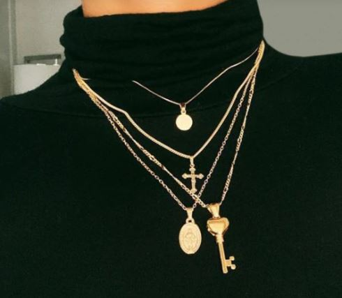 Gold stacked and multilayered chains for the fall season and fall outfits from dopefashionsense.com
