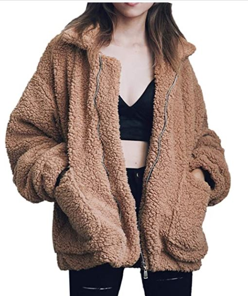 A girl standing with a brown coat. a girl wearing a brown faux shearling coat. trendy amazon fashion clothes. a girl with a black two piece one.
