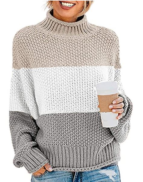 Amazon women sweater. A girl standing with coffee. a girl with stripe sweater. a lady smiling with some coffee