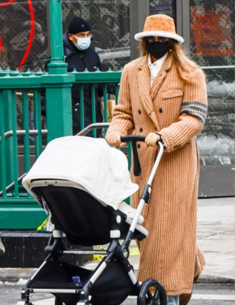 Gi Gi hadid walking her babyin nyc in a bucket hat. Jennifer Lopez was not the only celebrity to be pictured in the fashionable hat trend. Supermodel and new mom GiGi Hadid also was seen walking her baby in Dec. in the ultimate cool mom look. What completed this cool mom look would have to be the Louis Vuitton shearling bucket hat Hadid accessorized with.