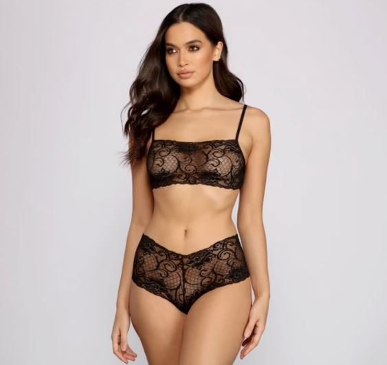 Lingerie for Valentine's day. a girl standing with lace lingerie. a girl posing for the camera. a girl modeling for windsor.