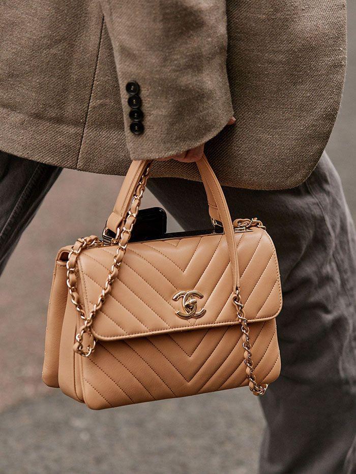 a lady walking with a chanel handbag. a rare chanel handbag. vintage chanel handbag