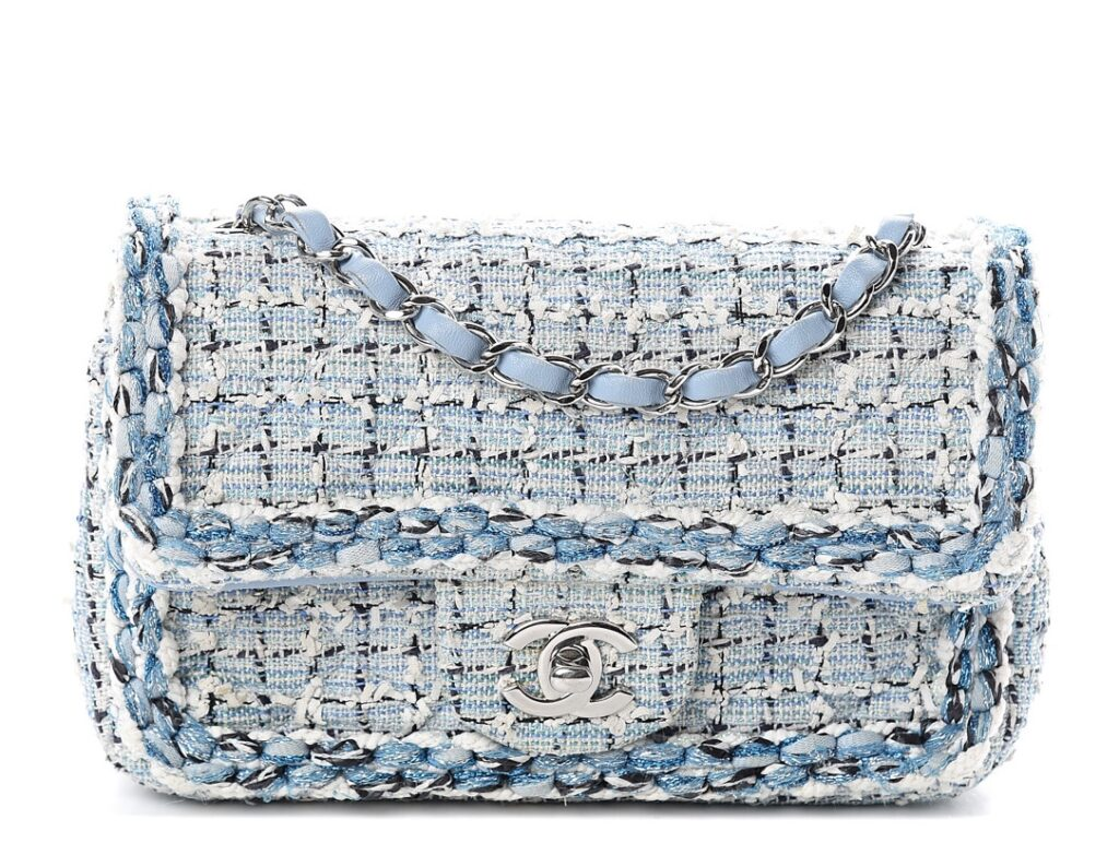 CHANEL Tweed Braid Mini Flap Blue White Navy or 100% of your money back. This stylish flap shoulder bag is crafted of colorful tightly woven tweed with diamond stitching. The bag features silver chain link shoulder strap threaded with blue leather, a front flap with a polished silver Chanel CC turn lock.
