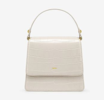 a white mini handbag. winter fashion handbags. winter inspired mini handbags. kylie jenner fashion style.