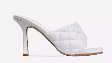 a white padded mules heels. bottega veneta heels dupe. winter fashion trends. winter fashion heels trend. white heels.