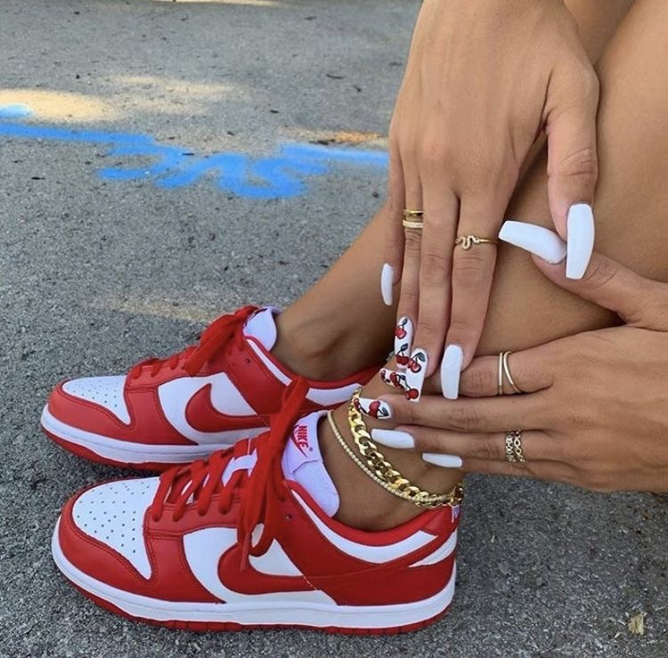 a girls nail designs. a girl with nail inspo. a girl with red sneakers, a girl with nike dunks on. A girl with gold jewelry.